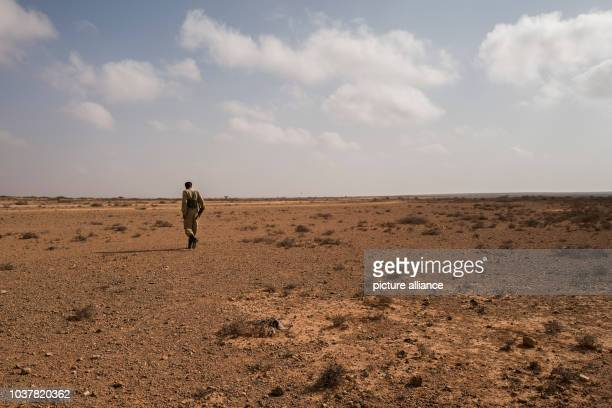 A member of the security forces on a stop on the journey from Garowe to the village of Uusgure some 160 kilometers away through the semidesert in...