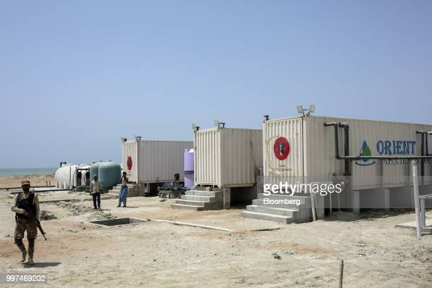 A member of the security forces walks through a desalination plant in Gwadar Balochistan Pakistan on Monday July 3 2018 What used to be a small...