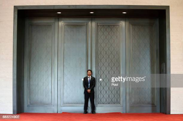 A member of the security personnel stands guard before the news conference by Chinese President Xi Jinping to conclude the Belt and Road Forum for...