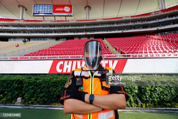 A member of the security staff wears a masks as part of the COVID 19 protocol prior to the match between Mazatlan FC and Tigres UANL as part of...