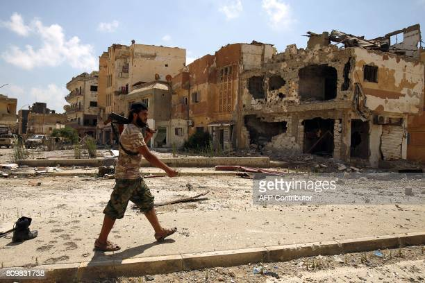 A member of the selfstyled Libyan National Army loyal to the country's east strongman Khalifa Haftar patrols a street in central Benghazi on July 6...