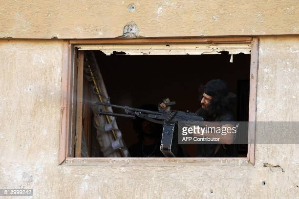 A member of the selfstyled Libyan National Army loyal to the country's east strongman Khalifa Haftar fires a machine gun during clashes with...