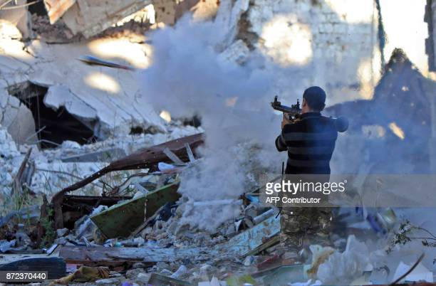TOPSHOT A member of the selfstyled Libyan National Army loyal to the country's east strongman Khalifa Haftar fires a rocket propelled grenade during...