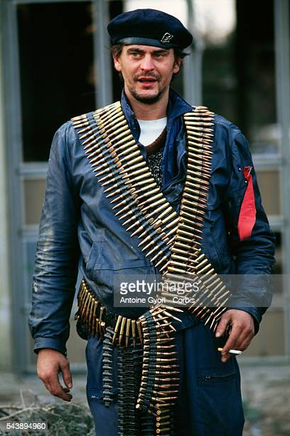 A member of the Serbian Volunteer Guard or 'Arkan's Tigers' wears ammunition during training exercises in Erdut during the Yugoslavian Civil War In...