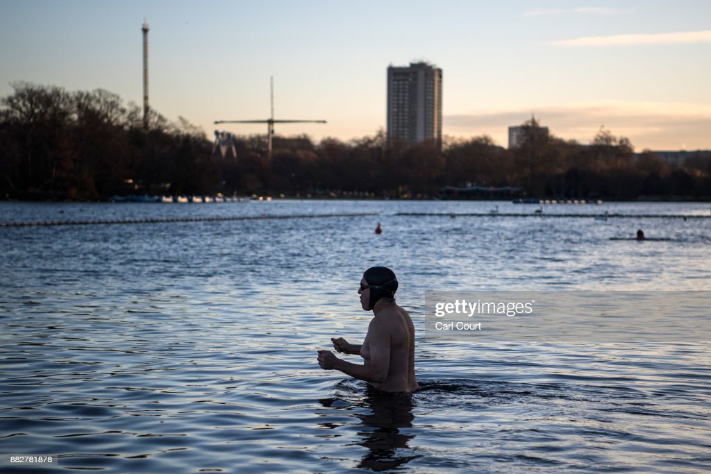 A member of the Serpentine Swimming Club enjoys an early morning swim in Serpentine Lake in Hyde Park on November 30, 2017 in London, England. Today marks a cold end to meteorological autumn with snow forecast in northern parts of the country.