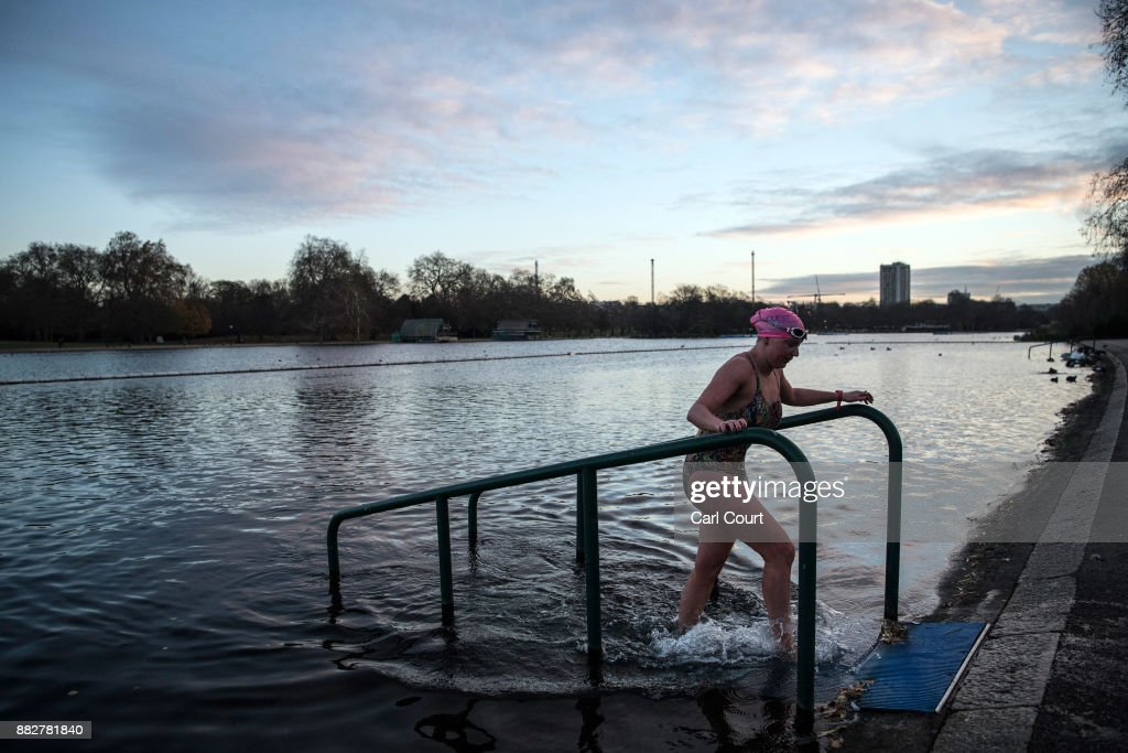 A member of the Serpentine Swimming Club leaves after enjoying an early morning swim in Serpentine Lake in Hyde Park on November 30, 2017 in London, England. Today marks a cold end to meteorological autumn with snow forecast in northern parts of the country.