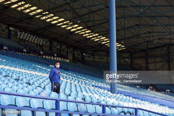 A member of the Sheffield Wednesday staff wears PPE looks out from empty stands during the Sky Bet Championship match between Sheffield Wednesday and...
