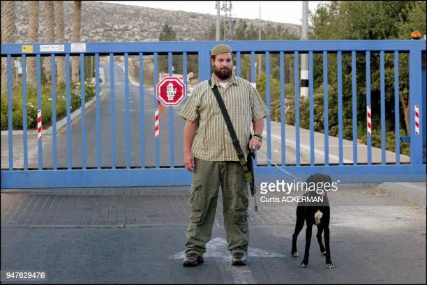 A member of the Shilo security team with his dog and M16 guards the main entrance to the West Bank settlement In Shilo as in other settlements...