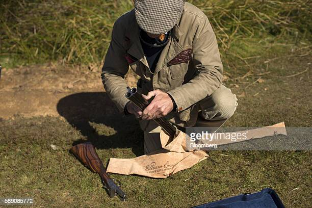 A member of the shooting party dismantles a Premium Connaught 12 bore shotgun manufactured by William Evans following a walked up grouse shoot on...