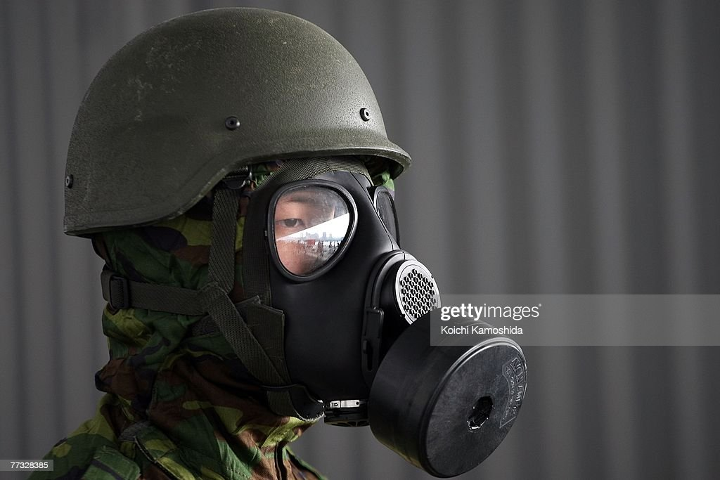 A member of the Singapore army wear gas masks while standing in exercise the removal of unidentified chemical substances with an anti-chemical suit during the Proliferation Security Initiative (PSI) Maritime Interdiction Exercise 'Pacific Shield 07', at Yokohama Port on October 15, 2007 in Kanagawa, Japan. Australia, France, New Zealand, Singapore, the U.K. and the U.S. will also participate in the Exercise. PSI is an international effort to halt the proliferation of weapons of mass destruction, missiles and related materials, threat to the peace and stability of the international community.