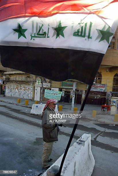A member of the socalled Awakening group also know as Concerned Local Citizens guards the entrance of a street in Baghdad's AlAdhamiyah district 08...