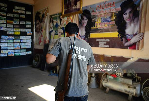 A member of the socalled selfdefense groups going to patrol at the El Aguaje community Michoacan state Mexico on February 15 2014 February 24 2014...