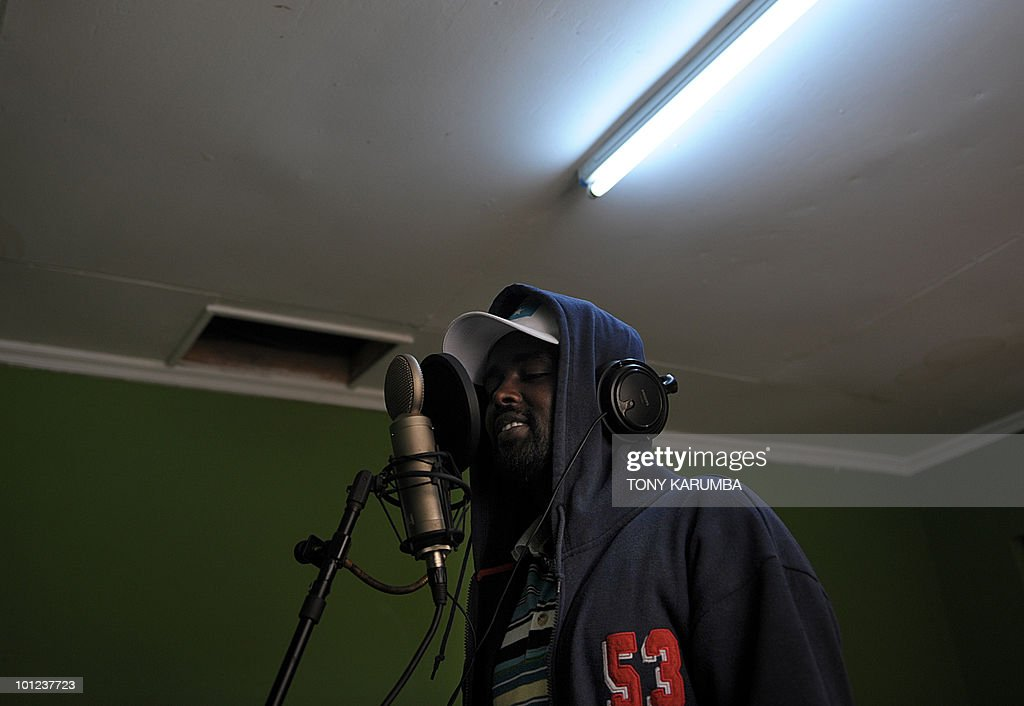 A member of the Somali rap group Waayaha Cusub (New Era in Somali), Shino Abdullahi, 27, sings on May 20, 2010 during a recording session at a makeshift studio in Nairobi. Refugees in Kenya since a very early age, the Somali rappers are defying through their lyrics Islamist warlords in their wartorn-country. The group of 10 members was founded in 2004 and quickly made a sensation by attacking the Somali warlords and making girls dance on stage. In recent months, the musicians are targetting the Somali hardline insurgent group, Al-Shehab, about whom they've composed and recorded six songs and a video clip. AFP PHOTO/Tony KARUMBA