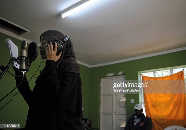 A member of the Somali rap group Waayaha Cusub sings on May 20 2010 during a recording session at a makeshift studio in Nairobi Refugees in Kenya...