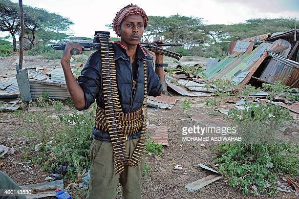 A member of the Somali security forces stands guard during an operation against AlShebab in Mogadishu on December 8 2014 AlQaedaaffiliated Shebab...