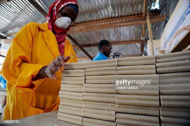 A member of the Somaliland Meat Development Association arrange bar soap made from camel bone marrow to dry before cutting and packaging them on...