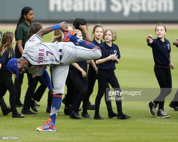 A member of the Sope Creek chorus gestures at shortstop Jose Reyes of the New York Mets while Reyes stretches before the game against the Atlanta...