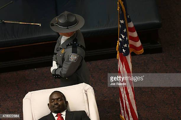 A member of the South Carolina Highway Patrol honor guard stands next to the open casket of church pastor and South Carolina State Sen Clementa...