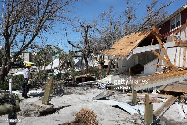 A member of the South Florida Search and Rescue team searches for survivors in the destruction left after Hurricane Michael passed through the area...