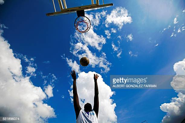 TOPSHOT A member of the South Sudan Wheelchair Basketball Association plays during the weekly training session at the Basketball Stadium in Juba...