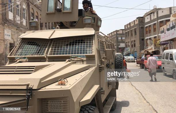 Member of the southern separatist movement rides an armoured military vehicle in Yemen's government-held second city Aden on August 11 following...