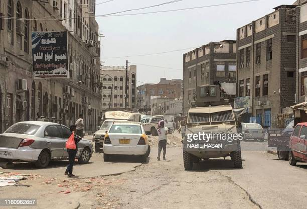 A member of the southern separatist movement rides an armoured military vehicle in Yemen's governmentheld second city Aden on August 11 following...
