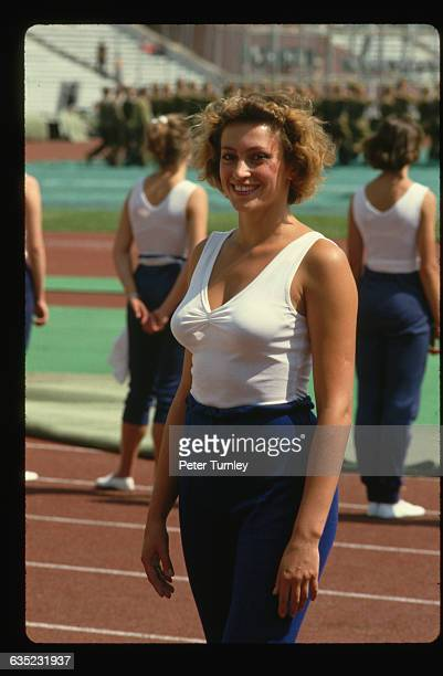 A member of the Soviet Union's women's track team poses on a running track at the 1986 Goodwill Games the very first year of the games which were...