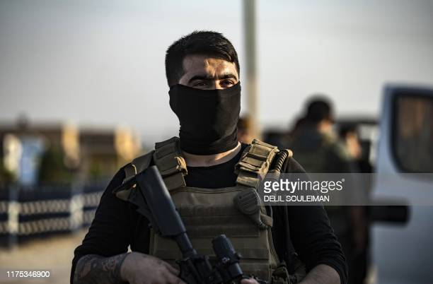 A member of the special forces of the Kurdishled Syrian Democratic Forces is seen during preparations to join the front against Turkish forces on...