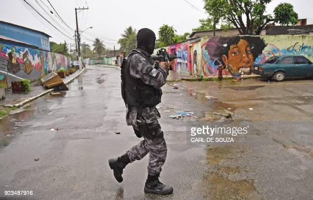 A member of the special military police shock troops patrols near the Vila Kennedy favela in Rio de Janeiro Brazil on February 23 2018 More than 3000...