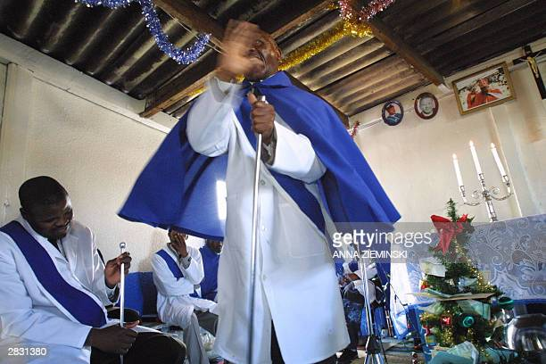 A member of the St John's Apostolic Faith Mission addresses the congregation during a Christmas service in Langa Cape Town 25 December 2003 AFP PHOTO...