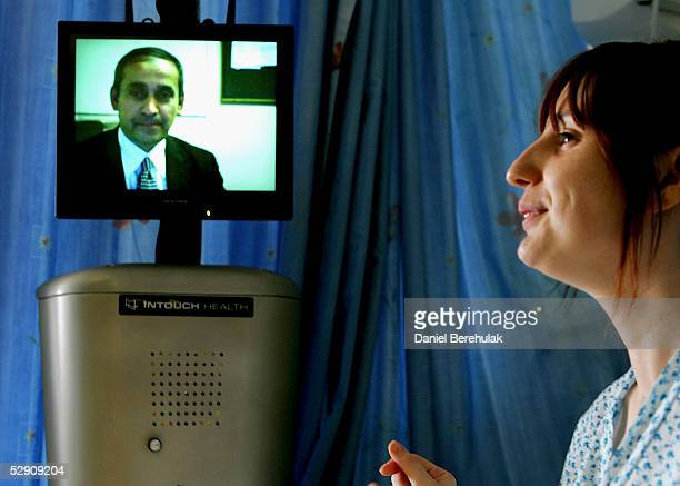 A member of the St Mary's Hospital medical staff operates the Sister Mary RP6 as he communicates with a patient via a remote console system on May 18...