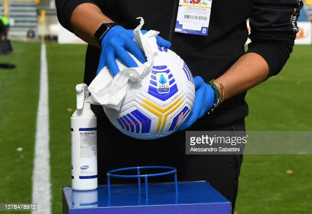 Member of the staff cleans the ball with anti bacterial spray during the Serie A match between Parma Calcio and Hellas Verona FC at Stadio Ennio...