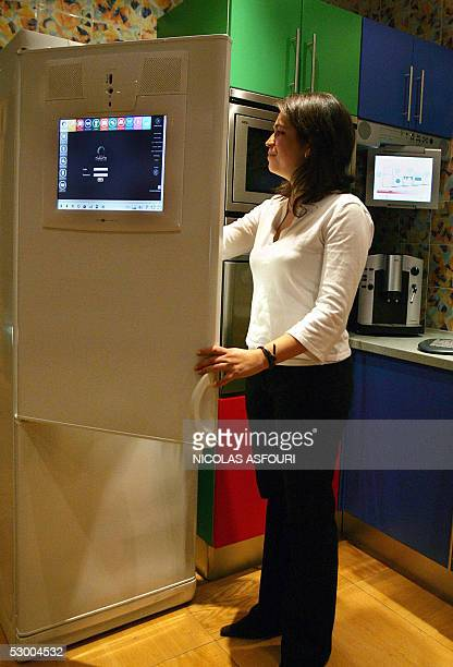 A member of the staff museum is checking food in a fridge inside the House of the Future exposed at the museum of communication in Lisbon 24 May 2005...