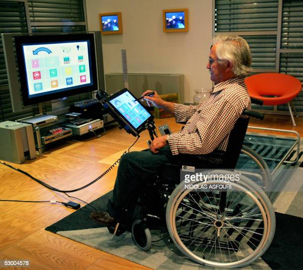 A member of the staff museum sits in a wheelchair and browses the internet and controls parameters such as the lights and the heating from a computer...