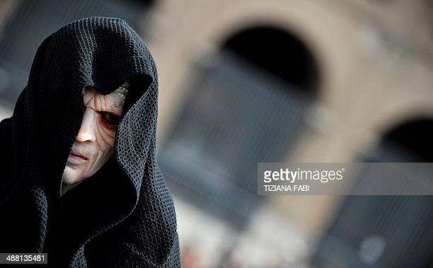 """Member of the Star Wars fan club dressed as Darth Sidious takes part in the """"Star Wars Day"""" in front of the Colosseum in central Rome on May 4, 2014..."""