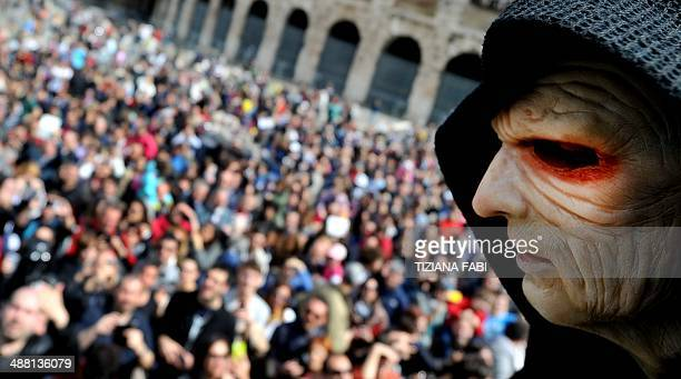 A member of the Star Wars fan club dressed as Darth Sidious takes part in the 'Star Wars Day' in front of the Colosseum in central Rome on May 4 2014...