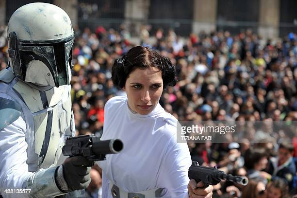 A member of the Star Wars fan club dressed as Princess Leia celebrates 'Star Wars Day' in front of the Colosseum in central Rome on May 4 2014 AFP...