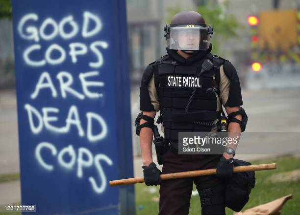 A member of the State Patrol stands guard on the fourth day of protests on May 29 2020 in Minneapolis Minnesota The National Guard has been activated...