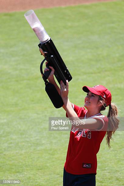 A member of the Strike Force of the Los Angeles Angels of Anaheim shoots tshirts to fans with an air gun before the game against the Seattle Mariners...
