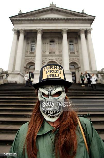 A member of the Stuckists who campaign against the pretensions of conceptual art protests outside the Tate Britain gallery where artwork shortlisted...