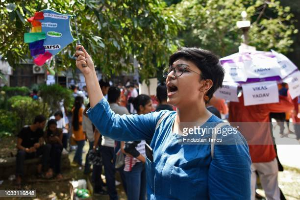 A member of the Students' Union shouts slogans in support of candidates during Jawaharlal Nehru University Students Union Elections at the JNU campus...
