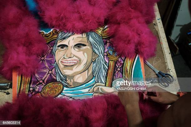 A member of the Sucesso street carnival batebola band stitches costumes in Rio de Janeiro Brazil on February 24 2017 The batebola or clovis...