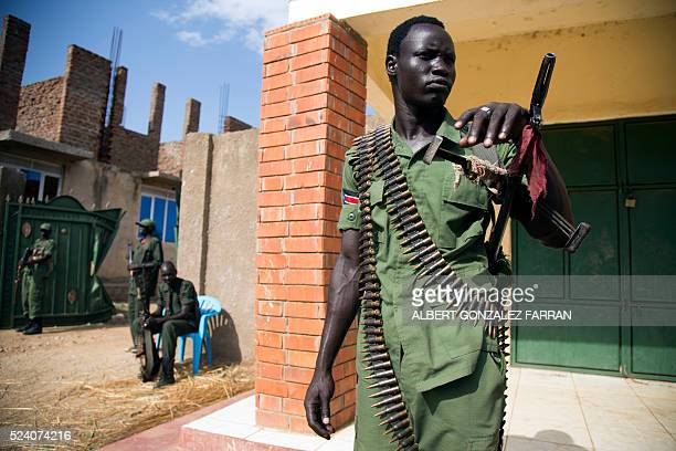 TOPSHOT A member of the Sudan People's Liberation Army in Opposition stand guard at the military site in Juba after the arrival of new troops and...