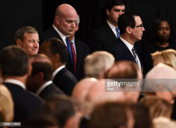Member of the Supreme Court Chief Justice John Roberts acting Attorney General Matthew Whitaker and Secretary of the Treasury Steven Mnuchin wait for...