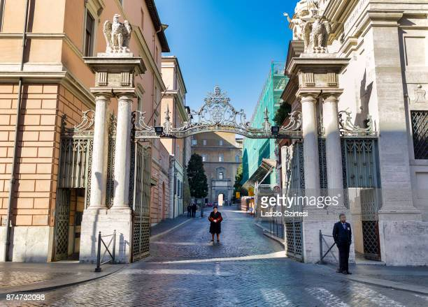 A member of the Swiss Guard is on guard at the entry 'Porta Sant'Anna' on November 1 2017 in Vatican City Vatican