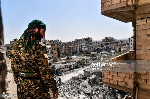 A member of the Syrian Democratic Forces backed by US special forces monitors the area on the western frontline in Raqa on October 8 2017 The SDF are...