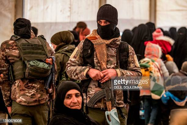 Member of the Syrian Kurdish internal security services known as Asayish stands guard during the release of persons suspected of being related to...