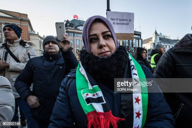 A member of the Syrian oppositions seen taking part in the protest while condemning the killings and crackdown of protesters by the Iranian clerical...