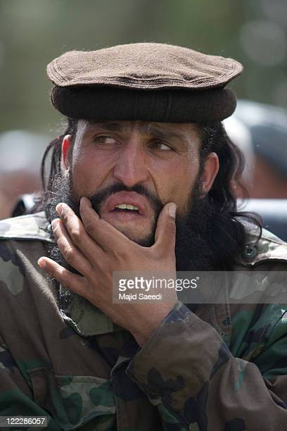 Member of the Taliban surrenders to the Afghan Government, on August 26, 2011 in Badakhshan, Afghanistan. More than 100 militants surrendered their...