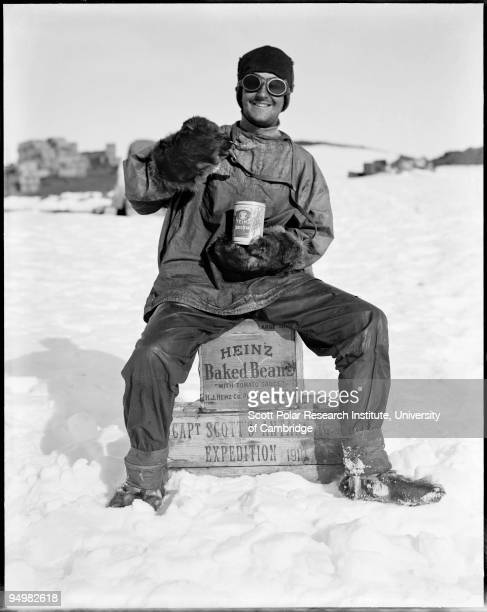 A member of the team tucks into a tin of Heinz baked beans in the Ross Dependency during Captain Robert Falcon Scott's Terra Nova Expedition to the...
